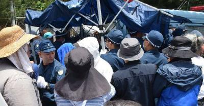 HaIxdNLG機動隊が日よけのテント撤去