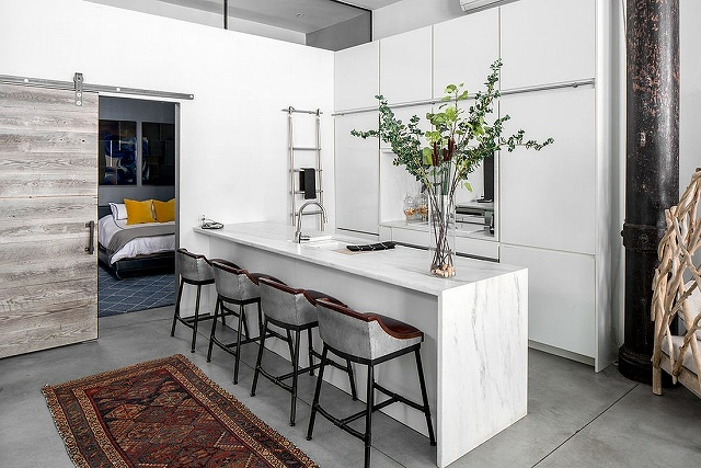 Modern-kitchen-in-white-with-bedroom-next-to-it-and-a-sliding-barn-door.jpg