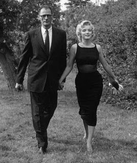 marilyn_in_1956_with_new_husband_Arthur_Millerin,_wearing_a_wool_crepe_Galanos_cocktail_dess_with_bare_chiffon_midriff