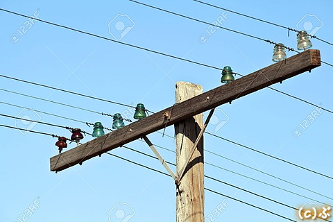5327267-Old-wooden-telephone-poles-with-glass-insulators-Stock-Photo.jpg