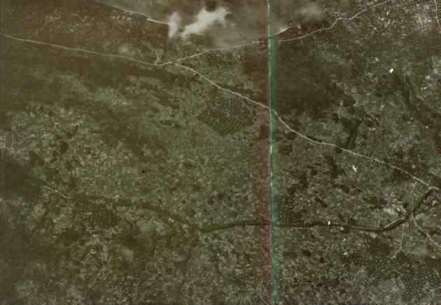 1944年(昭和19年)9月に米軍が上陸用の作戦地図をつくるために撮影した写真だそうです。民家もたくさんありますが、広大な畑が広がっている様子がわかります。