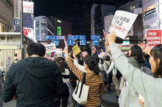 「戦争準備に向けたトランプ大統領の訪韓・訪日反対」キャンドルデモ