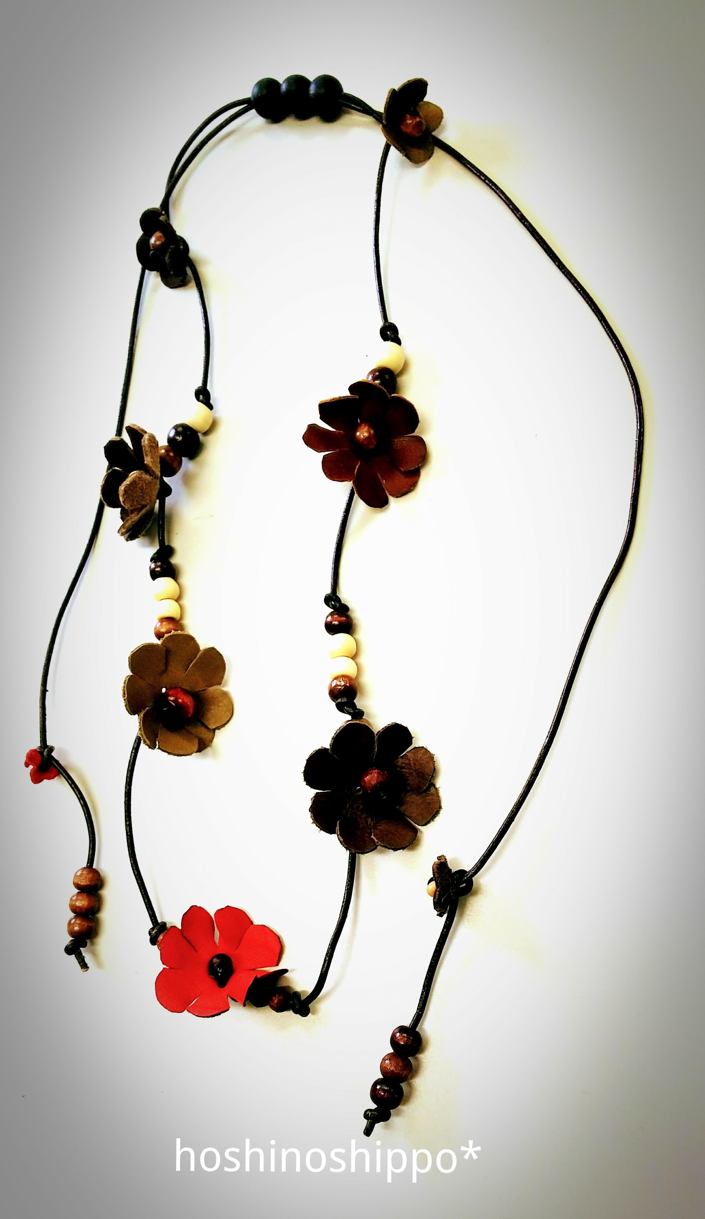 花の革紐ベルト